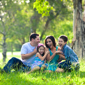 Family laughing during picnic in the park